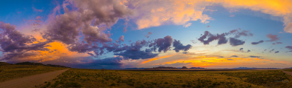 Photography of a Sunset in Utah's West desert.  Wild horses in the distance